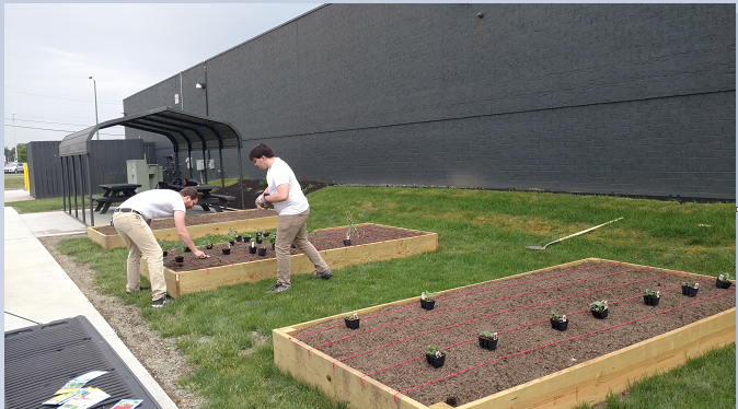 Volunteers ready the beds.