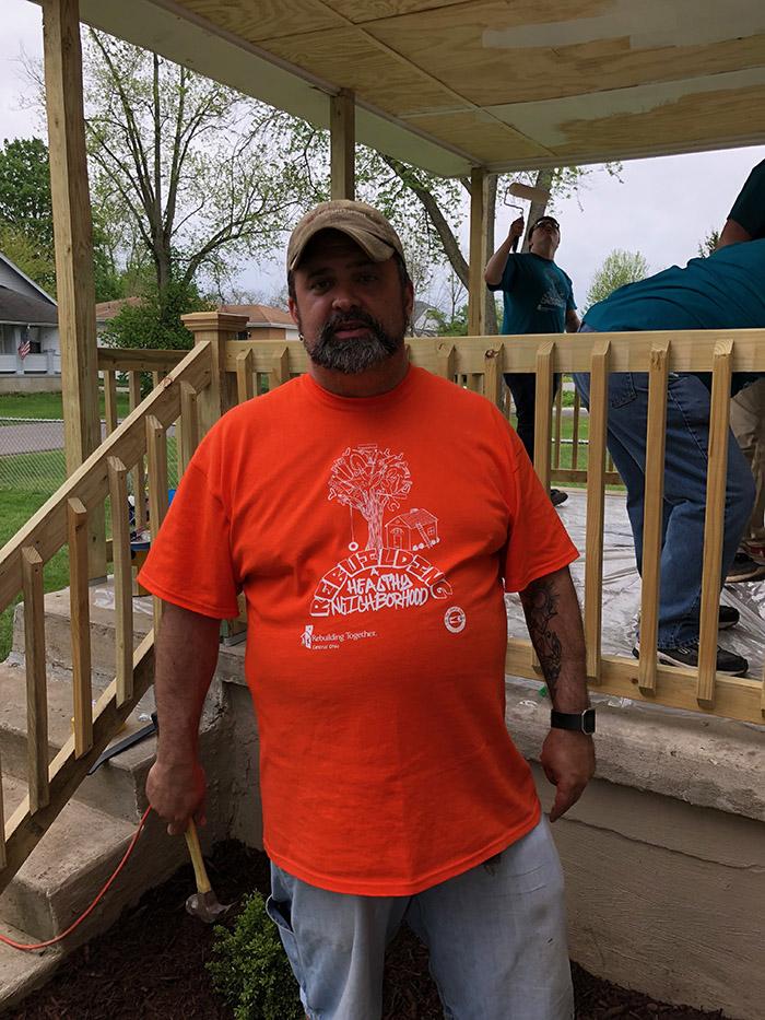 Jay is rocking the orange shirt