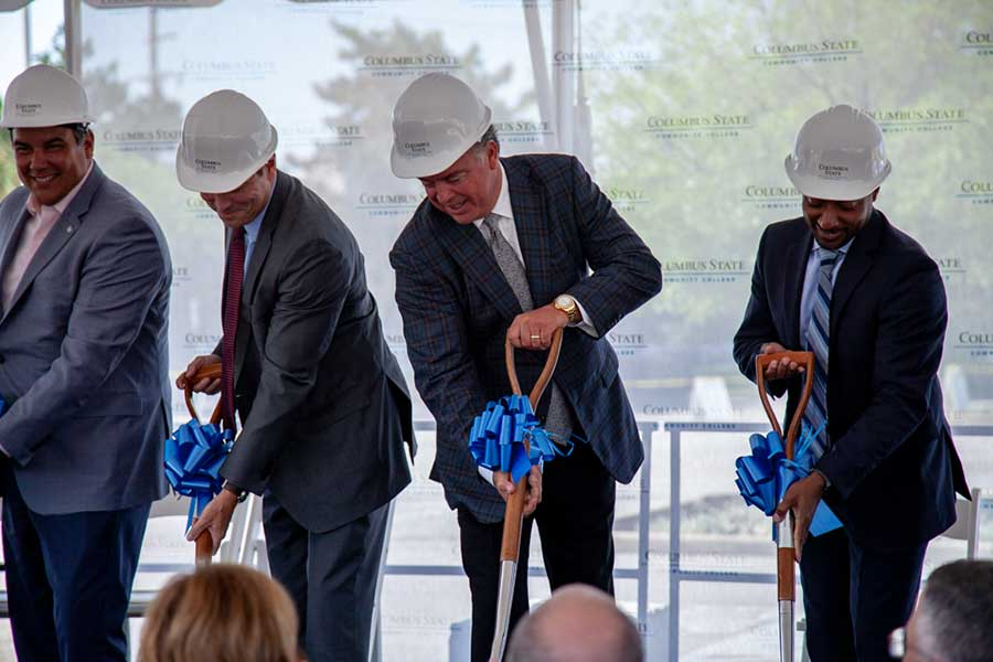 From L-R: Mayor Andrew Ginther, Columbus State President David Harrison, Cameron Mitchell, and President of the Franklin County Board of Commissioners Kevin Boyce break ground on the new facility.