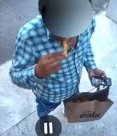 A delivery driver helps himself to your fries.