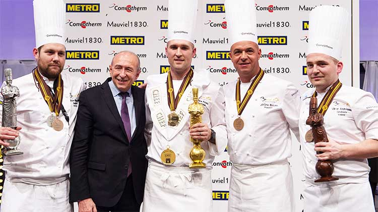 Winners of the 2017 Bocuse d'Or including Matthew Peters (USA, center), Christopher William Davidsen (Norway, left) and Viktor Andressen (Iceland, right).