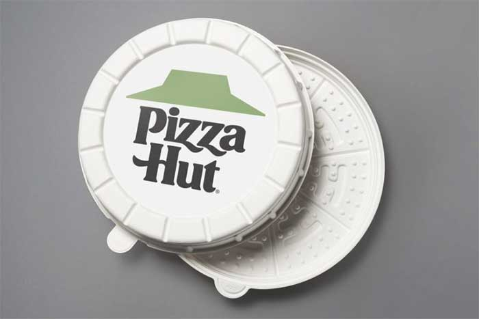Pizza Hut's experimental round box, complete with a special green roof logo.