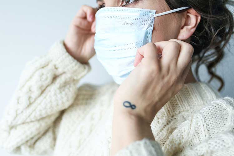 Properly position your disposable mask so that it covers your nose, mouth, and chin.