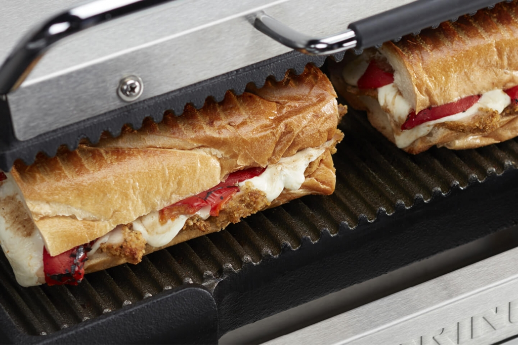 Ribbed plates of a Waring Commercial panini grill.