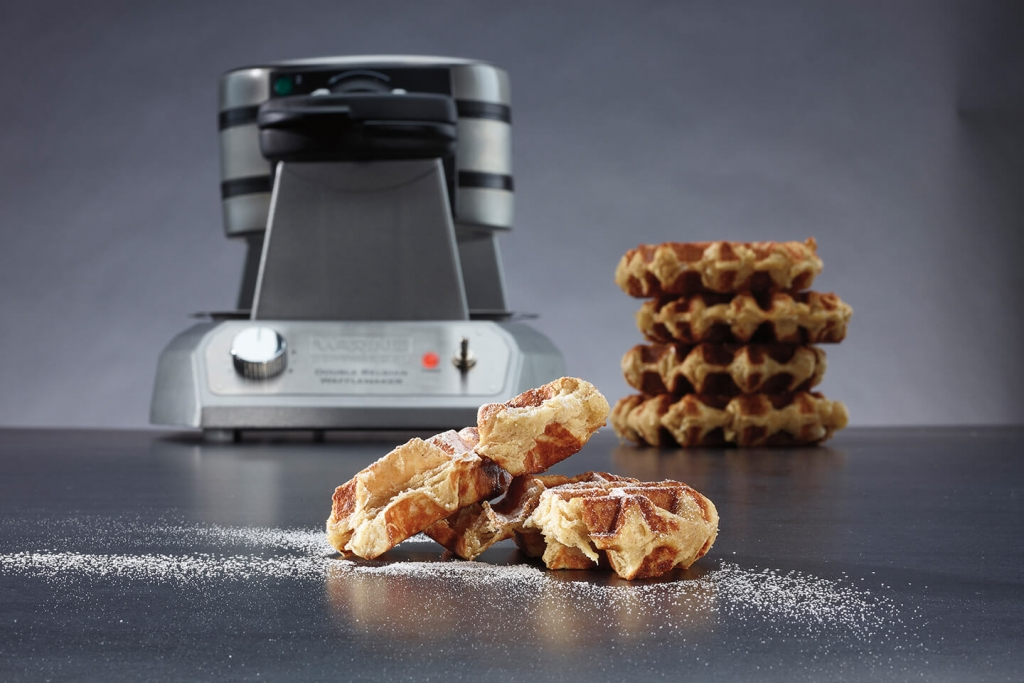 Sweet Belgian waffles and a commercial waffle maker.