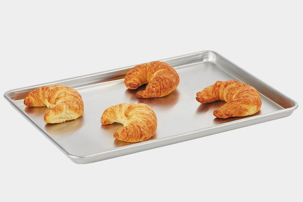 This 2/3 size Wear-Ever® sheet pan from Vollrath® features impact resistant, 3000 series aluminum and the tapered design allows for easy stacking. Perfect for bakeries.