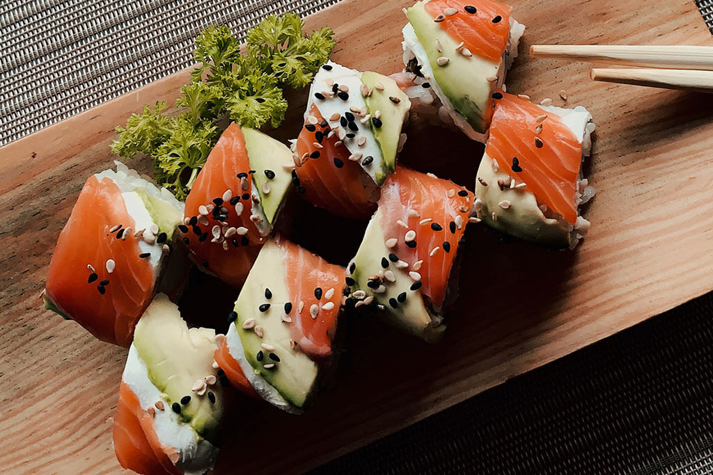 Sushi with sesame seeds.